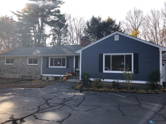 Norwich, CT - This home improvement project is now complete. New Harvey replacement windows installed and new Vinyl siding installed with new shutters and exterior trim.