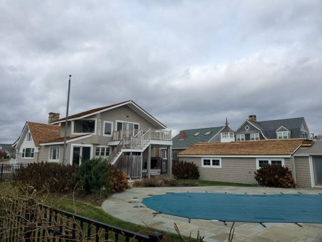 South Kingstown, RI - Progress being made on one of our wood roofing projects in South Kingstown RI.Using Pressure treated red cedar shakes.