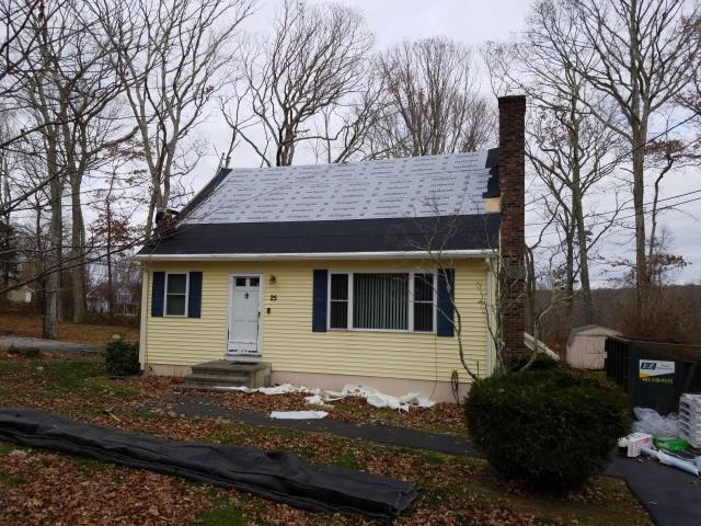 Ledyard, CT - Roof in progress today. Removed old layer of leaking shingles and will be installing new GAF Timberline HD roof shingles over all GAF accessories. System Plus warranty. Color will be Biscayne Blue