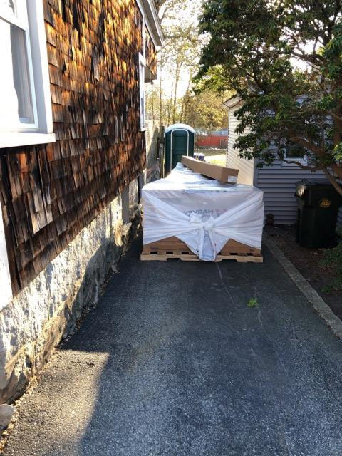 New London, CT - Material has been delivered to New London Ct residential home that will be getting new Vinyl siding installed. Also will be getting new Harvey Replacement Windows and new Entry Doors