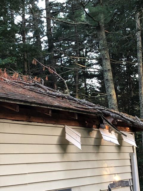 Hopkinton, RI - Fixing structural damage on a house in Hopkinton RI that had a tree fall during high winds. Also replacing the entire roof using GAF Timberline HD shingles. And replacing damaged siding and installing new Seamless gutters.