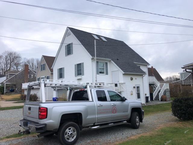 Groton, CT - Final clean up after a full roof replacement was completed in Groton Ct. New GAF Timberline HDZ shingles installed with a 50 year warranty backed up by GAF . Property was swept with rolling magnet for nails.