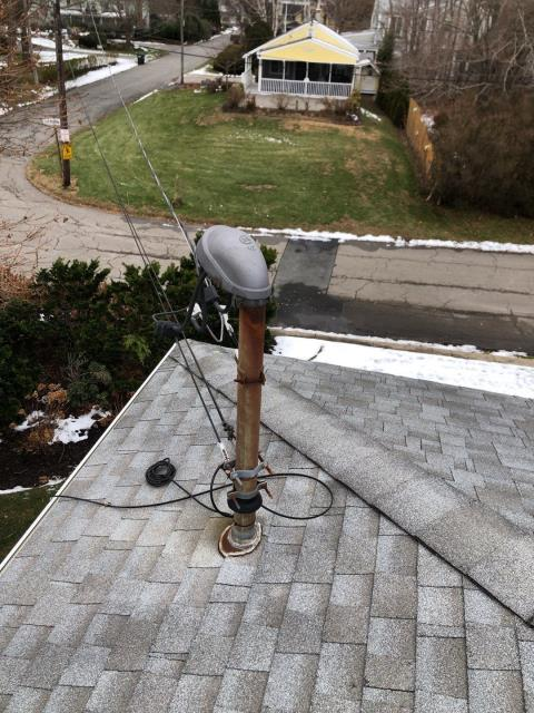 North Kingstown, RI - Tricky area to flash and install new shingles. Will use special pipe flashing to work around existing wires. GAF Timberline HDZ shingles will be a great looking shingle on this roof in North Kingstown RI