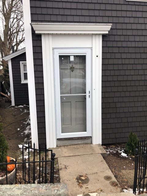 New London, CT - Installed a new storm door on entrance to a house we are installing new vinyl cedar impressions on in New London CT