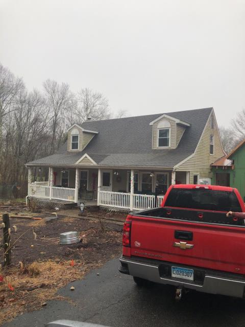 Preston, CT - Remove existing vinyl siding and gutters and install new vinyl siding to match new garage addition. Install new seamless gutters with stainless steel gutter guards.