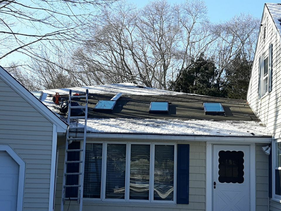 Exeter, RI - It's a lovely day to replace some skylights!3 new Velux skylights, GAF Weather Watch ice and water membrane, flashing, and new GAF roofing shingles for the finish.