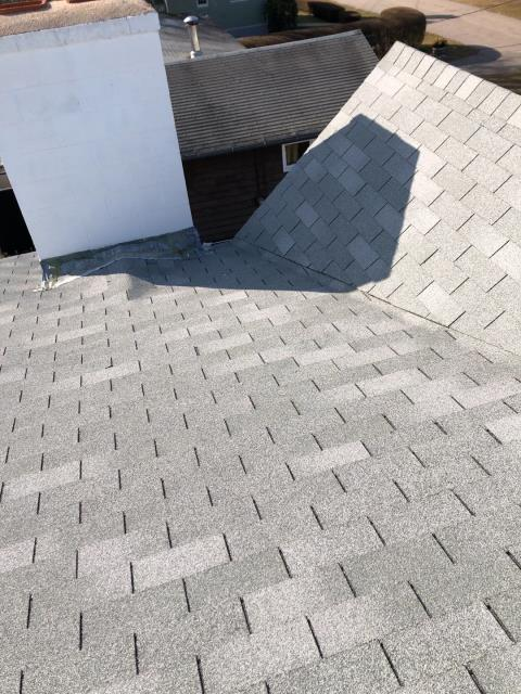 Ledyard, CT - Roof inspection in Ledyard CT. These three tab shingles are new, need to match with new shingles on other side of ridge.