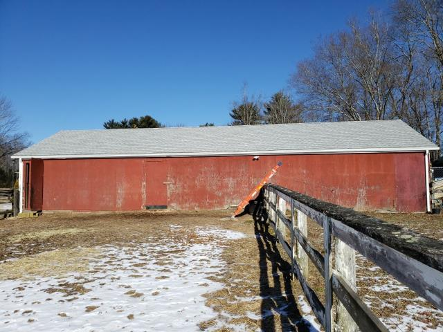 Glasgo, CT - New White seamless gutters installed on this barn in Voluntown Ct. Full roof replacement was already completed by our crew. A new GAF Timberline HDZ roof shingle was installed