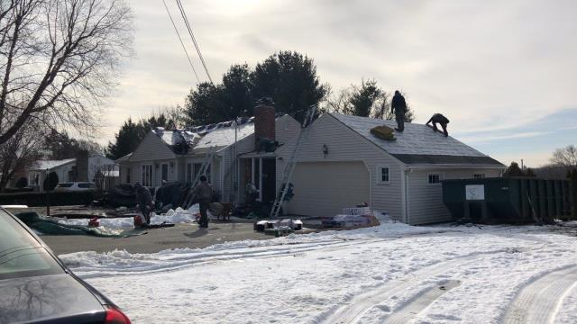 Johnston, RI - This roof replacement in Johnston RI is under way! New roof in one day! Zero percent financing! GAF TimberLine HDZ shingles being used. Unlimited wind warranty! New to the market. Color Charcoal. system plus warranty