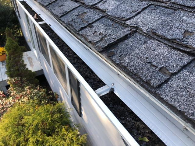 Ledyard, CT - This roof in Ledyard Ct is way past its life span. The shingles are dried out and filling the gutter up. This roof needs to be completely removed and a new roof system be installed. We recommend using the new GAF Timberline HDZ shingles with a full gaf factory warranty for 50 years, Golden Pledge. Pewter grey would be closest matching color.