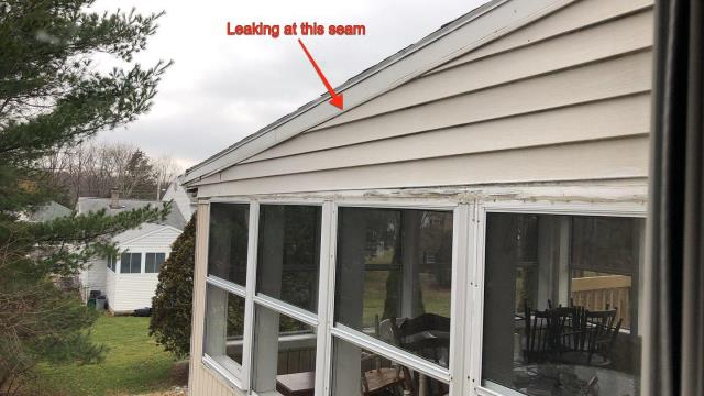 Ledyard, CT - Inspecting a property in Ledyard Ct for a siding leak. This rake trim needs to be built out over the J-channel to allow water to drain on top of siding. When the existing roof shingles are removed we will add build out to rake trim.Also will  Wrapping exposed wood trim.