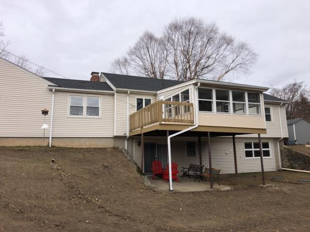 Johnston, RI - New white seamless aluminum gutters installed today in Johnston RI. We also did a full roof replacement using GAF'S new Timberline HDZ shingles! Golden pledge warranty, new chimney flashing, and repaired exterior trim.