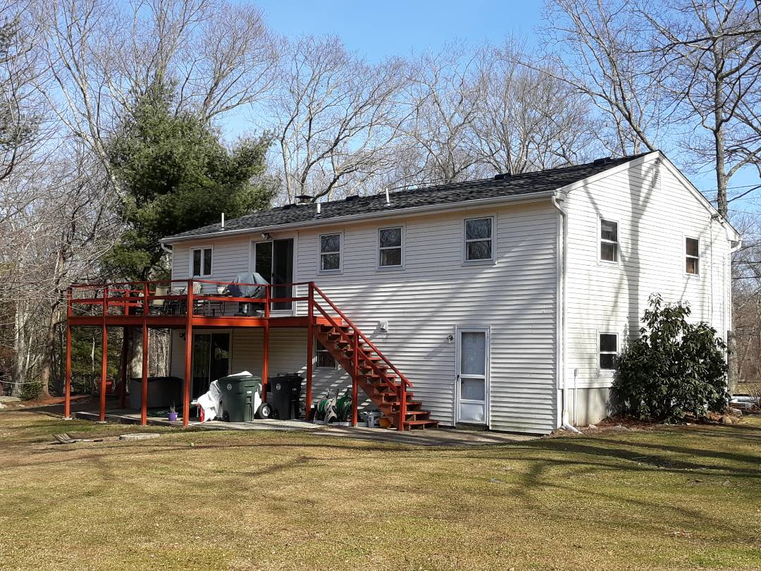 Coventry, RI - Done in half a day! New Pewter Gray GAF Timberline HD Ultra roofing shingles and matching GAF Timbertex ridge caps over GAF Weather Watch ice and water membrane, GAF FeltBuster synthetic underlayment and eight inch drip edge, with new plywood and new chimney lead flashing!