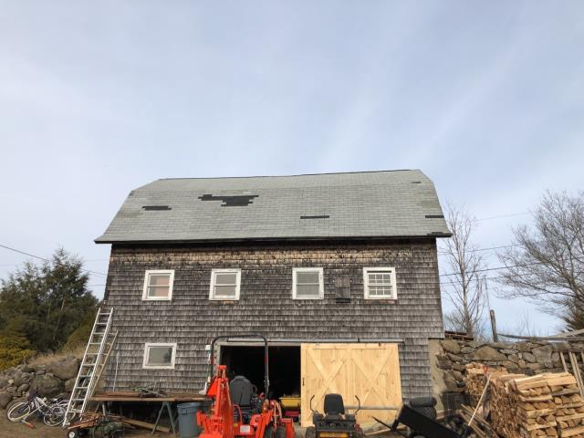 Richmond, RI - Wind damage on this barn roof. This roof is going to be fully replaced. All new plywood sheathing will be installed and a new GAF Roof system using the new GAF timberline HDZ roof shingle.