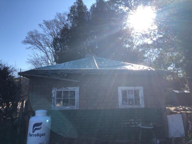 Richmond, RI - This garage roof was damaged by wind storm. Insurance is covering a full roof replacement. Storm damage is covered under most homeowners insurance policies
