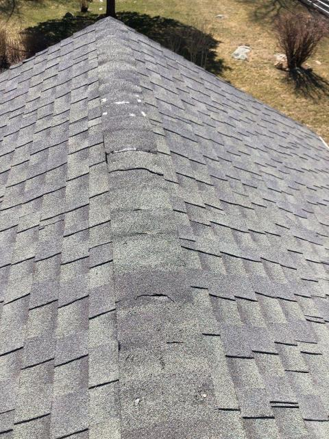 New London, CT - Inspecting a damaged roof in New London Ct from high winds. This roof will be replaced with a new GAF Timberline HDZ roof shingle with a lifetime warranty!