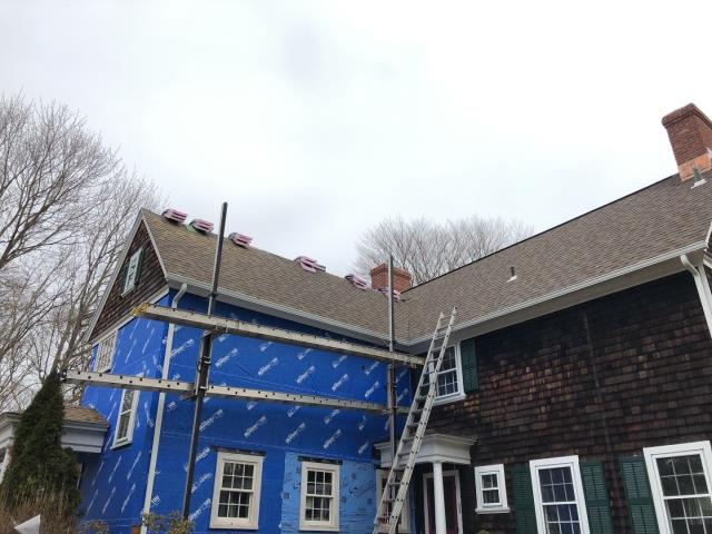 North Kingstown, RI - Making progress on a partial roof replacement in North Kingstown RI . We matched existing roof shingles using Owens corning roof shingles.