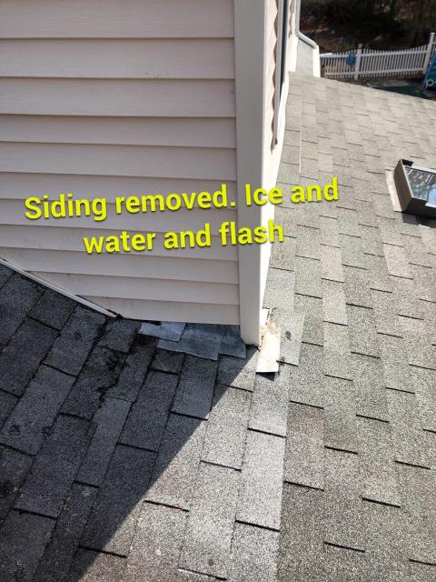 Hopkinton, RI - This roof is leaking. Siding needs to be removed to allow new flashing to be installed. We will remove siding and run Ice & Water up side wall. This house in Hopkinton RI  will be getting a full roof replacement.GAF Shingles will be installed. A full GAF roof system will be installed.Full Factory warranty