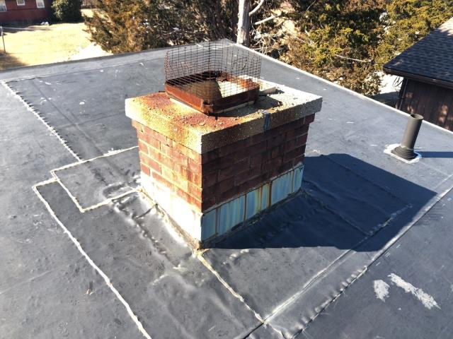 East Lyme, CT - This rubber roof needs to be replaced. Homeowner has been repairing this roof for years, time for a full roof replacement. New rubber roof