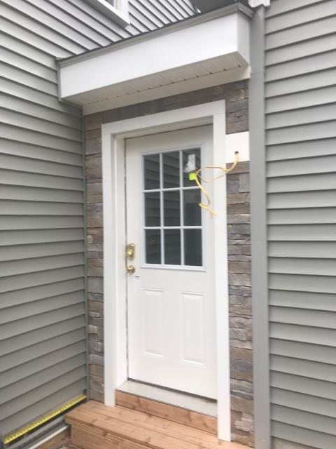 Preston, CT - New Stone facade installed on this siding project in Preston CT. All new vinyl siding being installed.