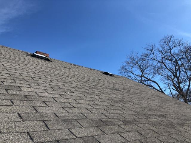 Narragansett, RI - Missing pieces of shingles found on the lawn helped this homeowner to see that they need a new roof! Homeowners insurance company is looking into full coverage of this roof. The damage is wind damage. A new GAF Timberline HDZ shingle with unlimited wind coverage is a great option.