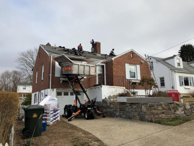 New London, CT - Equipter is in use today on this roof replacement project in New London CT. New roof no Mess!
