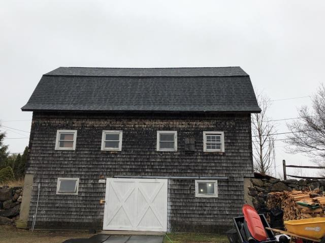 Richmond, RI - This roof is complete. New Gaf roof installed over new plywood sheathing. System plus warranty.Color Charcoal