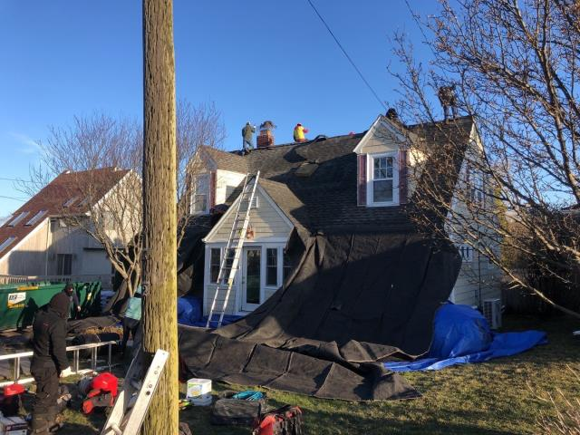 Narragansett, RI - This roof replacement in narragansett RI is under way today. Two layers of Old shingles being removed and a new GAF roof system being installed.