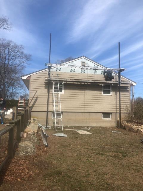 Hopkinton, RI - Crew is making progress on one of our siding projects today. Installing new Vinyl cedar impressions. New Harvey replacement windows and a GAF roof system.