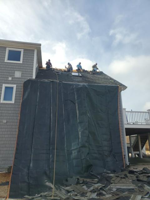 Charlestown, RI - Roof in progress today in Charlestown RI today. Heavy duty tarps are in place to protect the house from falling debris. A new GAF Roof system is being installed using GAF Timberline HDZ Shingles.