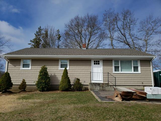 Hopkinton, RI - New white seamless gutters installed today in Westerly RI. New GAF roof system was installed using GAF Timberline HDZ roof shingles color weathered wood. Also installed new Cedar impressions vinyl siding
