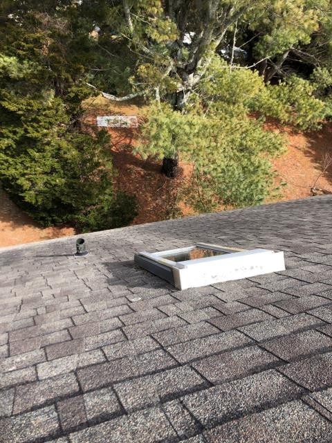 Charlestown, RI - View from a steep roof top  in Charlestown RI, This roof is in need a replacement. Proposal includes a new VELUX skylight replacement. Best  time to replace skylights is during a full roof replacement. VELUX has many great options on skylights.