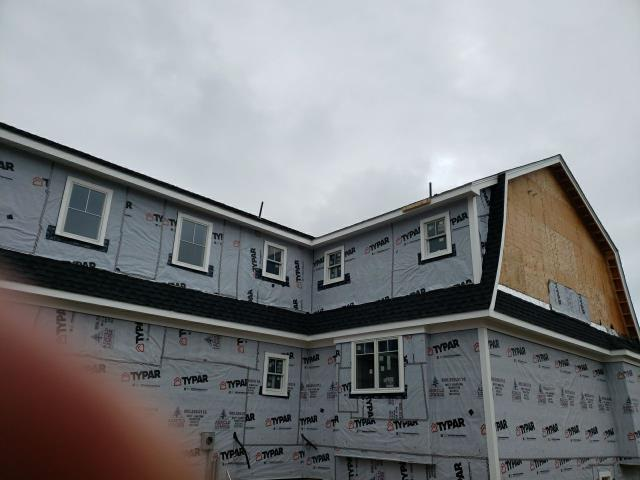 Charlestown, RI - New construction roof installed on the Rhode Island Shore line. GAF Timberline Ultra HD shingles installed. Back helping Plumber to install pipe flashings on recently added vents.Golden Pledge warranty