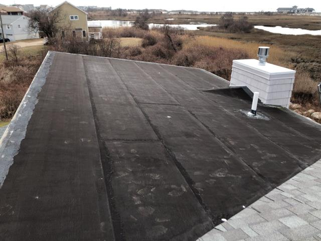 Narragansett, RI - This leaking low pitched roof will be replaced with a new GAF Roof system.