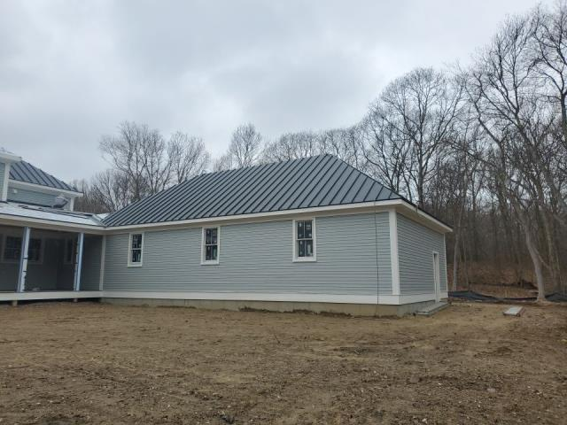 South Kingstown, RI - Progress is being made in Wakefield RI on one of our Metal Roofing projects. This drexel metal roof has a lifetime Warranty. This roof looks great with the trim details and new wood clapboard siding.