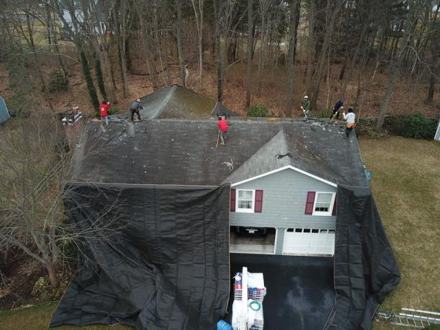 North Kingstown, RI - Crew is on site today in North kingstown RI doing a full roof replacement project. New Roof no mess. REplacing this old roof with a new GAF Timberline HDZ Roof shingles.