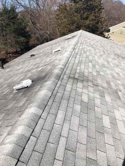 Richmond, RI - Roof inspection on a 18 year old three tab roof. These shingles will be removed and we will be installing a new GAF Timberline HDZ roof system!