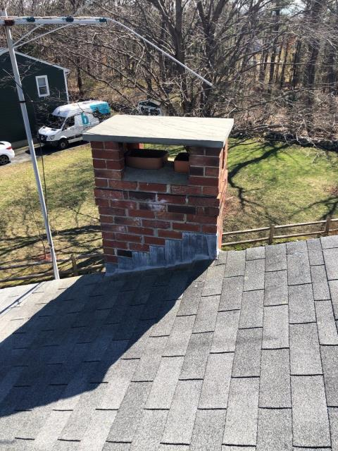 Oakdale, CT - This chimney will be resealed after this roof is replaced. Lead will stay but will be counterflashed for extra protection.