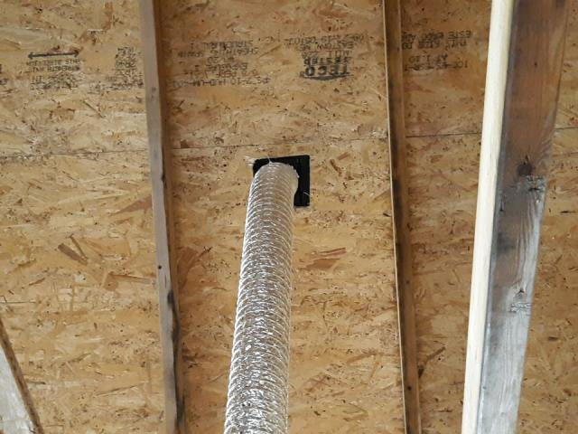 Narragansett, RI - Inspecting attic on this property in Narragansett RI. This Bathroom vent was just installed to make sure the bathroom fan vents out of the house. This new construction home had the GAF Timberline ULTRA HD shingle installed with a Golden Pledge warranty.