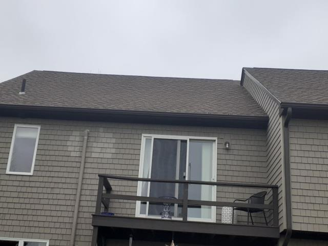 North Kingstown, RI - Roof repair on this roof in North Kingstown RI,, This recently replaced condo roof job needed a few touch ups where new vents were added.