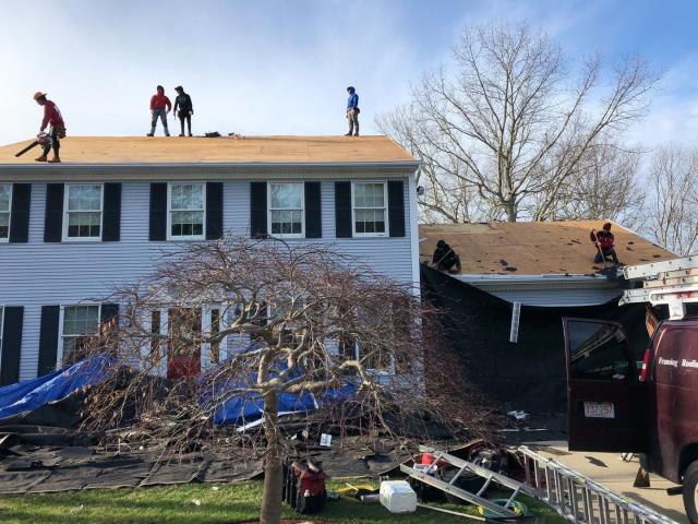 South Kingstown, RI - Crew has the old roof almost 100% removed by 8:30! This full roof replacement will be a one day job. The new GAF timberline HDZ shingles are already on site and about to start the installation of all the GAF accessories.