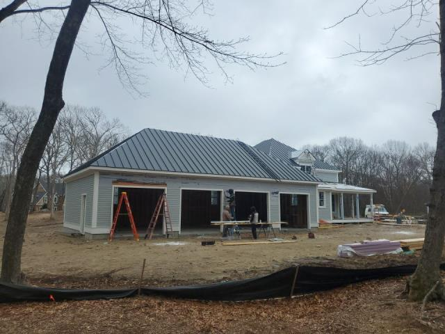 South Kingstown, RI - Our standing seam metal roofing crew is on site today in Wakefield RI.This new construction roofing project is nearing completion. This standing seam metal roof is going to really complement the design of this home and add real curb appeal!