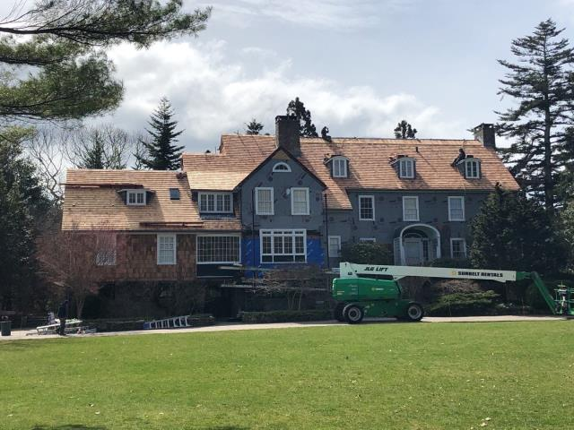 South Kingstown, RI - Crew is making great progress on this wood roof replacement project in South kingstown RI. Front elevation of this home is almost complete. We are install red cedar shingles on entire roof.