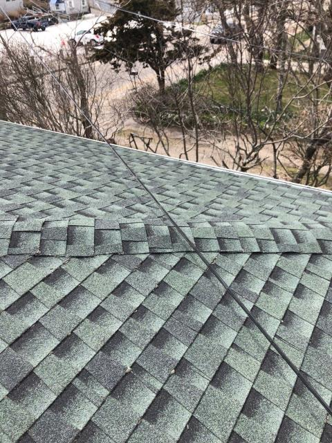 Narragansett, RI - While Inspecting a roof in Narragansett RI came across this. Last contractor used Architectural shingles to cap this ridge! Will be replacing with GAF Timber tex Cap shingles. Also will be replacing a small section of this roof that is leaking due to improper flashing and shingle installation.