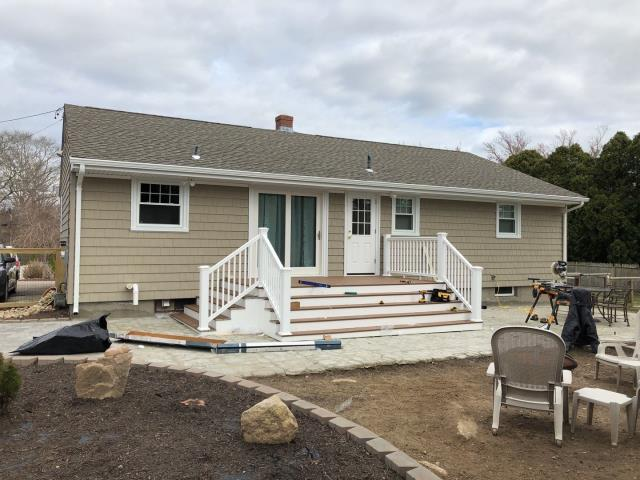 Hopkinton, RI - Installing new vinyl railings on this deck in Westerly RI. On this project we replaced the old roof, siding,gutters  and windows and now installing new PVC railings on this deck.