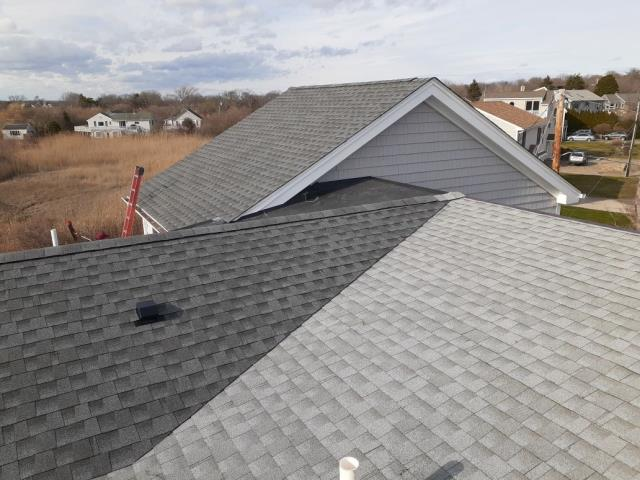 Narragansett, RI - This is a first for JHC! Two different colors on one roof! The homeowner wanted lightest color on low pitch roof where you cant see from ground and darker color where it is visible. New Gaf Timberline HDZ Shingles installed with a system plus warranty! Full roof replacement Narragansett RI.