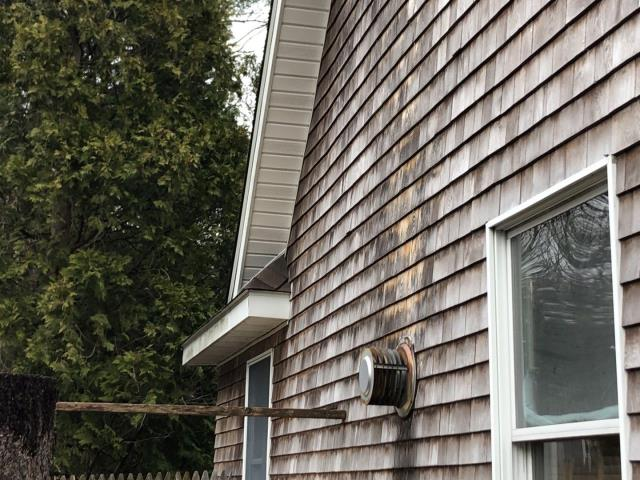 """Charlestown, RI - Measuring this cottage for new siding. Homeowner wants maintenance free options. Cedar impressions or new double 4"""" vinyl siding are two options Along with Azek PVC trim"""