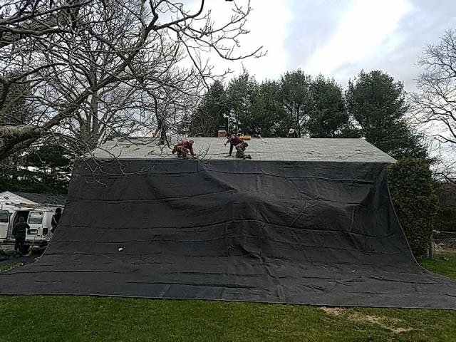 Groton, CT - This roof is being protected with heavy duty tarps to protect this house during the roof replacement process. This roof in Groton CT is getting replaced today! We are using GAF Timberline HDZ roof shingles and all GAF accessories and putting a Golden Pledge Warranty on it!