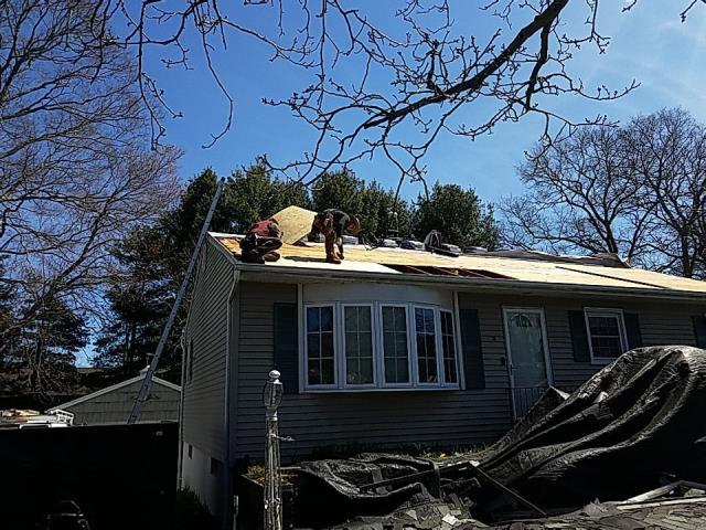 Groton, CT - Crew is replacing damaged plywood before installing the new GAF roof system.