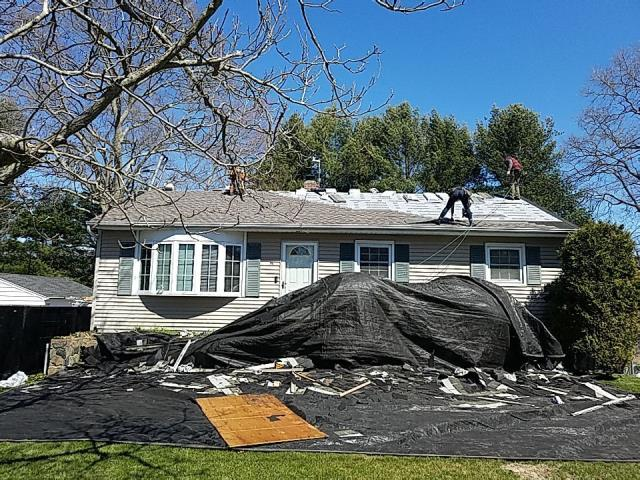 Groton, CT - The Crew is starting to install the new GAF Timberline HDZ roof shingles over the GAF  accessories , Homeowner went with the Color Mission Brown. Golden Pledge.